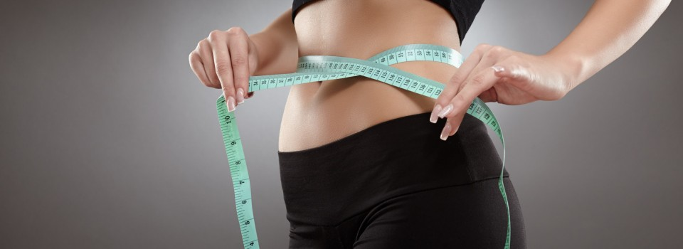 Image a woman with a tape measure around her waist